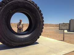 Nick Richardson looking through 190 Ton truck Tire - Rio Tinto Largest Boron Open Pit Mine in Boron, CA (mikebaird) Tags: mine nick riotinto mining boron richardson openpit mikebaird nehrus