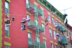 Yarn bombed shoes (WindUpDucks) Tags: street nyc pink urban newyork art shoe graffiti knitting shoes chinatown crochet yarn hanging suspended knitted crocheted bombing bombed guerilla yarnbombing yarnbombed