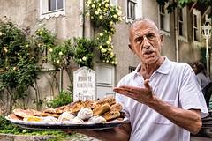 Istanbul street vendor: anger arising (Louise Lindsay) Tags: trip turkey happy travels baker may istanbul angry gesture merchant sophia mideast hagia 5913 2013