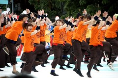 Dancers at the Yosakoi Soran Festival in Sapporo (Troy Jack) Tags: girls people orange festival japan catchycolors happy japanese dance sapporo energy hokkaido group excited mass excitement yosakoi odt soran energetic