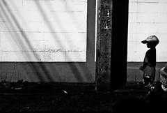 """What's ahead of you?"" (Angelo G.I.O.) Tags: street morning people bw streets monochrome hat lines composition contrast thailand 50mm lights daylight morninglight blackwhite lightsandshadows nikon asia shadows child availablelight bangkok streetphotography silhouettes daytime nikkor naturalight thaipeople shadowlight morningtime blackandwhitecontrast thehumanelement d3000 streetsofbangkok nikond3000 phetkasem phetkasem69 maneewattana"