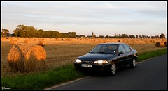 Ford Mondeo (Bould'Oche) Tags: france cars ford car french photo photographie thomas quality voiture german mondeo mk1 worldcars maheut vision:sunset=0635 vision:outdoor=0941 vision:car=0526 vision:clouds=0752 vision:sky=0823