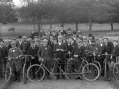 On a bicycle made for three (National Library of Ireland on The Commons) Tags: waterfordbicycleclub bicycles moustaches caps smoking badges cycling ahpoole arthurhenripoole glassnegative ireland nationallibraryofireland munster triplet triples biggearratio pneumatictyre safetybicycle peoplespark gofftrack corneliuspatrickredmond banquo bicicletas poolephotographiccollection