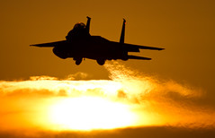 Low approach into the sunset (Nick Collins Photography, Thanks for 2.75m views) Tags: eagle aircraft military jet strike usaf raf lakenheath f15e usafe {vision}:{sky}=077 {vision}:{sunset}=0679