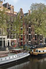 Prinsengracht scene, Amsterdam, Nederland (Ministry) Tags: prinsengracht prinsensluis amsterdam netherlands nederland grachtengordel canal warehouse shutters barge streetart boat tree spring bicycle graffiti