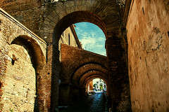 Roman Houses (occhio-x-occhio) Tags: rough watermark clouds architecture brown morning web street oxo rome buildings brick arch pinterest g flickr