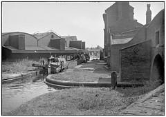 Canal off Broad Street Birmingham (geoff7918) Tags: canaloffbroadstreet birmingham worcesterbar gasstreet butty narrowboat boatman dog transhipment