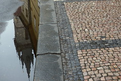 Puddled Reflection of the Church of Our Lady before Týn (Hythe Eye) Tags: prague praha czechrepublic churchofourladybeforetýn reflection pavement gutter puddle