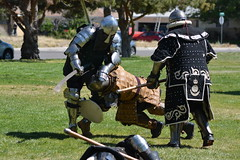 Mid Evil Fight Club (sasquatchii) Tags: knockdown hit tackle trip jab swipe slash washingtonpark newmexico albuquerque park competition armored armor knights thefallen victory poleax ax sword renascence midevil