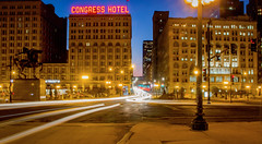 Congress Hotel in Chicago (T P Mann Photography) Tags: chicago illinois traffic light lights night city blur stream streaks long exposure movement urban downtown congress cityscape buildings architecture grant park low blue hour lamp lamps post street rush action