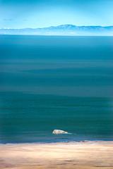 Lonesome rock sticking out of the water (joshhansenmillenium) Tags: nikon photography d5500 hiking adventure nature utah salt lake city antelope island sunset moon animals coyotes buffalo bison mountains tamron 18200mm frary peak great