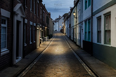 Hermitage St, Whitby (aevo69) Tags: whitby street photography quaint cobbles cobbled period vintage timeless dark night lamp illuminated terraceseaside village town andy evans andyevanscreations