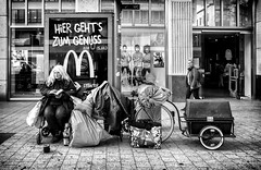 HiER GEHT'S ZUM GENUSS (Mister G.C.) Tags: street urban photography blackandwhite bw juxtaposition eyecontact poverty hannover germany