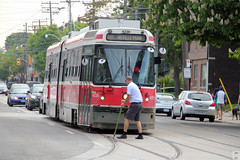 Manually switching a streetcar track turnout (Canadian Pacific) Tags: toronto ontario canada canadian city urban aimg3828 ttc tram streetcar queenstreet e east driver 4236 articulated