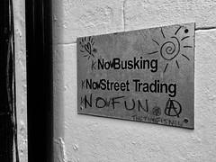 No Busking No Street Trading NO FUN (Pickman's Paintbrush) Tags: brighton 2017 spring grafitti blackandwhite bw thelanes sign iphone