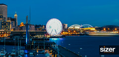 Seattle Waterfront (Dave Sizer) Tags: seattle waterfront tourism great wheel reflection clouds sunset night photography