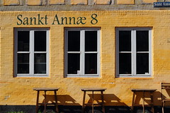 Sankt Annae 8 (dennis.harville) Tags: nordic scandanavia travel canon canont3i 50mm architecture denmark europe cafe street wall window yellow dslr coffeeshop