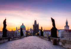 Charles bridge at sunrise (DaLiu_) Tags: architecture prague landmark city tower europe sky history river bridge building czech republic cityscape town view charles castle urban european vltava sunset travel tourism old praha blue landscape capital cathedral church famous panorama sightseeing house water historical scene ancient bohemia medieval street sun gothic outdoor exterior skyline beautiful historic karluv