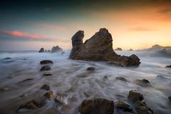 Corona Del Mar, CA (Roving Vagabond) Tags: coronadelmar ocean water sea rocks longexposure sand seascape landscape socal california ca westcoast usa clouds sun newport beach