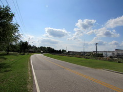 Looking Down Liberty Hill Road. (dccradio) Tags: lumberton nc northcarolina robesoncounty outside outdoors tree trees greenery leaf leaves street sky clouds libertyhillroad yellowline whiteline grass lawn road powerlines electriclines utilitylines