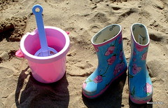 Sandcastle building (mootzie) Tags: pink blue beach fun bucket sand shadows memories rubber plastic sandcastle wellies spade