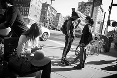 little flat iron (omoo) Tags: newyorkcity girls bw cars apple bicycle bench traffic manhattan tights bicycles streetscenes bwphotograph girlwithcellphone greytights meatmarketdistrict applechelsea west14thstreetandninthavenue applecorner outsideapple chelsrea sidewalkinfrontoftheapplestore littleflatiron lookingsouthtothewestvillage