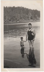 father and son (lydiafairy) Tags: old summer vacation two lake reflection water vintage pose found waves quiet silent sweet father son collection oldphoto vernacular awkward chubby foundphoto bathingsuit vintagephoto ipaidaquarterforthis orphanedreletives icollectotherpeoplesfamilies