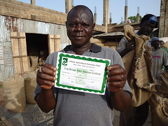 Large-scale farmer, Alhaji Alhassan Gunda Zakaria of the Gunda Producing Company in Tamale, northern Ghana holds up an agriculture insurance certificate from the Ghana Agriculture Insurance Programme. Credit: Albert Oppong-Ansah/IPS (IPS Inter Press Service) Tags: africa albert ghana agriculture insurance programme gunda alhassan zakaria alhaji smallholderfarmers oppongansah