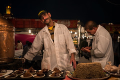 Khoudanjal Street Seller (aminefassi) Tags: world life africa street travel portrait people copyright food shop night lumix place candid culture morocco maroc getty marrakech souk worker marrakesh tradition seller souq moroccan  photographe fna fooding maroca