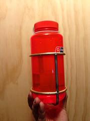 (ericmonasterio) Tags: usa silver bottle hand steel cage made custom nalgene em brass monasterio stainless uploaded:by=flickrmobile flickriosapp:filter=nofilter racerracks raccerracks