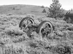 Rolling Wheels (snappytiger) Tags: trees blackandwhite mountains west abandoned nature wheel rust decay historic ghosttown weathered wyoming miner sagebrush