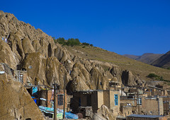 Carved Home In The Village Of Kandovan, Iran (Eric Lafforgue) Tags: city travel roof sky sculpture house mountain colour history tourism rock horizontal architecture outdoors photography design town asia day village iran middleeast persia bluesky carving valley environment weathered copyspace ukrainian troglodyte cultures arid pers eroded rockformation kandovan traveldestinations colorimage iraan  buildingexterior agingprocess nonurbanscene  persien islamicrepublicofiran  iro  builtstructure residentialstructure ir westernasia chandovan  humansettlement   frs      iran0282 belarusian iran