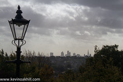 Lamppost and a view over the city of London from Alexandra Palace (www.kevinoakhill.com) Tags: pictures park blue ladies girls shadow sky hot men london tower boys wet lamp bicycle silhouette st skyline cheese canon eos cycling photo women october warm kevin cross post photos oakhill picture sunny super palace dirty lamppost alexandra cycle 7d marys alexandrapalace ax 27 shard gherkin grater 42 supercross muddy alexandrapark cyclocross cyclo rapha walkie talkie rouleur 2013 raphasupercross