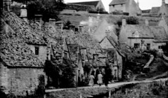 England 1938, Bibury Arlington Row 20-033 (rich701) Tags: england blackandwhite bw london castle church windmill thames 35mm vintage garden 1930s bradford compton 1938 rustic cottage negative stonehenge windsor winchester corfe bradfordonavon wisley avebury burton cirencester thatched silburyhill castlecombe lacock bibury elstead thursley shere witley thatchroof filmroll blewbury greywell tilford hagbourne uptongrey corfevillage wanborough hendred aldsworth arebury arelingtonrow staintcross