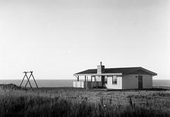 lonely house on the seaside (ViktorDobai) Tags: autumn sea blackandwhite bw black monochrome sepia architecture analog landscape denmark blackwhite seaside antique balticsea northsea analogphoto