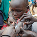A child in Tergol town receiving a measles vaccination