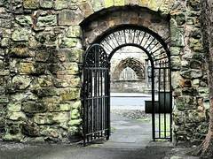 Open Gate to St. Andrews Cathedral. (Flyingpast) Tags: gate cathedral building ruin stonework ancient fife scotland scottish historic standrewscathedral old street visitscotland arch doorway detail