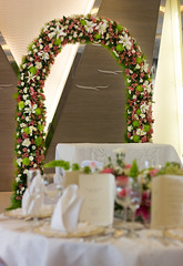 Wedding Party Table Near Wedding Arch (WOW Philippines Travel Agency) Tags: wedding bride groom flowers roses bouquet food weddingfood cake philippines filet mignon bearnaise sauce ravioli duck liver smoked salmon parmesan cutting display pink icing table party setup rings beautiful cream artichoke soup canonigo mango balls