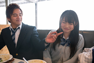 High school student couple in restaurant