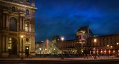 Paris, Louvre (Luc Mercelis) Tags: paris louvre sonyslt77v minolltaprimelens20mm minoltaprimelens24mm minoltaprimelens blue bluehour bluesky textureeffects architecture cityscape city citytrip cityoflight people red yellow bleu piramide museum