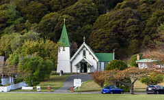 Church of Saint Patrick 1864 (Jocey K) Tags: newzealand southisland canterbury bankspeninsula akaora scene hills trees church churchofsaintpatrick1864akaroa architecture buildings cars signs notices