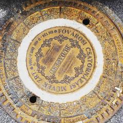 Decorative manhole (VillaRhapsody) Tags: budapest pest hungary citytrip city winter iron metal circle manhole ground