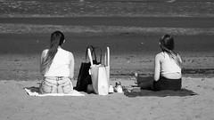 beach life 011 (byronv2) Tags: beach shore sand sun sunny sunlight sunshine spring portobello coast coastal peoplewatching candid street edinburgh edimbourg scotland blackandwhite blackwhite bw monochrome girl woman towel picnic bag sea seat sitting seated forth firthofforth rnbforth river riverforth northsea water people sit
