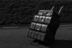 Travellin Light (MrAlbionMan) Tags: display luggage railwayplatform blackandwhite suitcases trolley