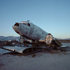boneyard. tucson, az. 2015. (eyetwist) Tags: eyetwistkevinballuff eyetwist nose cockpit c47 dc3 dakota tucson usn navy usaf airforce arizona boneyard airplane mamiya 6mf 50mm kodak portra 160 mamiya6mf mamiya50mmf4l film ishootfilm 6x6 analog desert urbex graveyard aircraft planes analogue emulsion mamiya6 square 120 filmexif epsonv750pro filmtagger ishootkodak americantypologies southwest usa junkyard scrap junk decay derelict abandoned rusty scrapped douglas transport ww2 old superdc3 c117 gooneybird faded patina wings shredder recycled gone american west amarc amarg iconla sunset