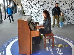 Girl on piano (sander_sloots) Tags: girl piano playing singing meisje people delft station train trein klavier leather jacket beautiful dame zingen spelen mensen