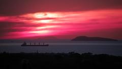 Sunset Explosion (Tassos Giannouris) Tags: sunset sun explosion sea clouds sky red orange water seascape kos greece cielo holiday mar island ship olympus