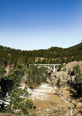 beaver creek bridge (almostsummersky) Tags: stone rock arch beavercreek bridge nationalpark stream blackhills southdakota snow trees creek road forest architecture deckarchbridge beavercreekbridge winter gorge windcavenationalpark custer unitedstates us
