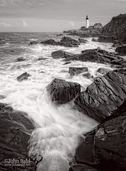 Incoming Wave, Portland Head Light, Cape Elizabeth, Maine  (79000 BW) (John Bald) Tags: fortwilliams maine portland portlandheadlight blackwhite capeelizabeth coastal lighthouse ocean rocks rockycoast rockyshore slowshutter slowshutterspeed wave
