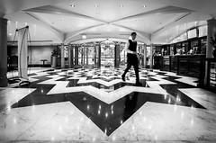 Hotel Panamericano Hall (hzeta) Tags: hotel panamericano buenos aires argentina hall lobby interior architecture arquitectura person persona symmetry simetria black white blanco y negro bw bn